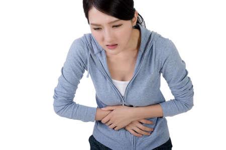 diarrea: mujer asiática joven con dolor de estómago Foto de archivo