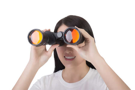 using binoculars: woman using binoculars, closeup portrait Stock Photo