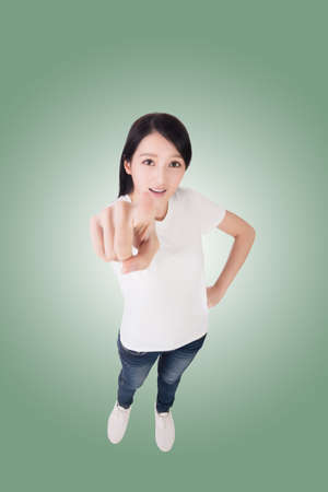 picking fingers: point, Asian woman give you a sign. High angle picture.