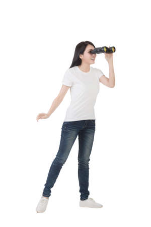 using binoculars: woman using binoculars, studio shot portrait
