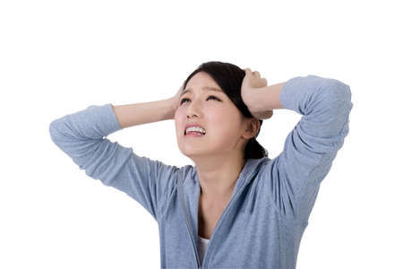 terrified woman: asian woman face with sadness, closeup portrait Stock Photo