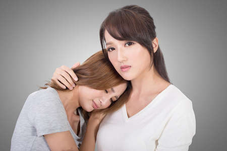 comforted: Troubled young girl comforted by her friend. Stock Photo