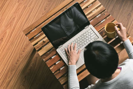 work at home: concept of woman work at home, Asian woman using laptop in a room
