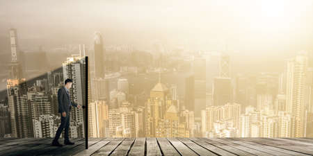 futuristic man: business man open a door, concept of change, challenge, future etc.
