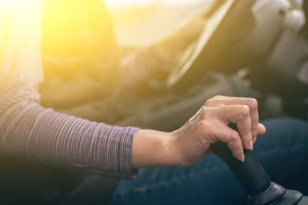 gearbox: woman hands of a driver on gearbox of a car with copyspace