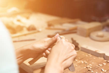 carpentry: woman carpentry at home, wooden work concept Stock Photo