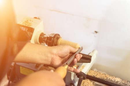 turning: worker turning wood on a lathe Stock Photo