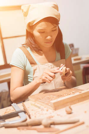 woman carpentry at home, wooden work concept Stock Photo