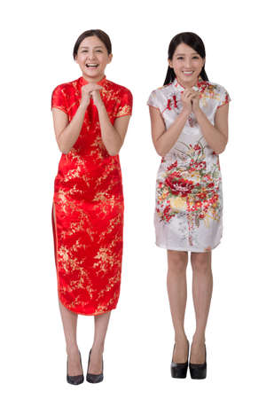 cheer full: Chinese woman in traditional cheongsam in the new year