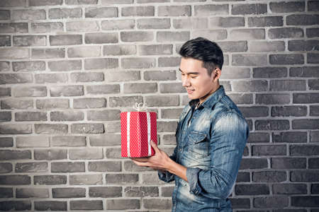 Asian young man hold a gift box