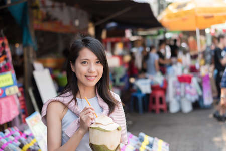 asian young woman traveling and shopping at Chatuchak weekend market, Bangkok, Thailand
