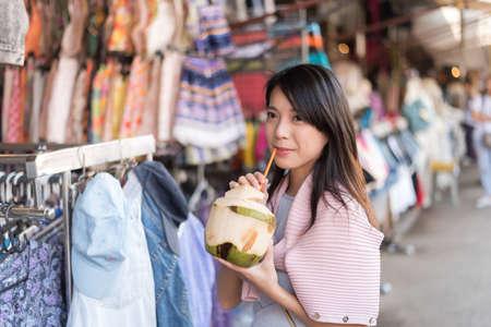 young asian: asian young woman traveling and shopping at Chatuchak weekend market, Bangkok, Thailand