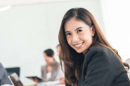 Smiling business woman portrait of Asian Banco de Imagens