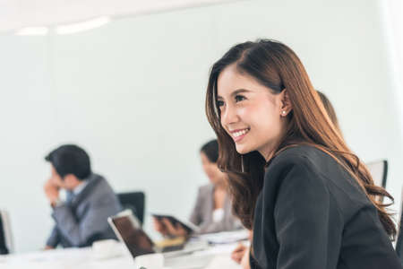 Smiling business woman portrait of Asian Standard-Bild