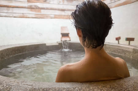 hot asian: rear view of asian mature woman at the hot spring pool