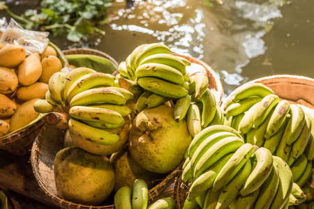 ferrying: fruits and vegetables at the floating market in Bangkok, Thailand Stock Photo