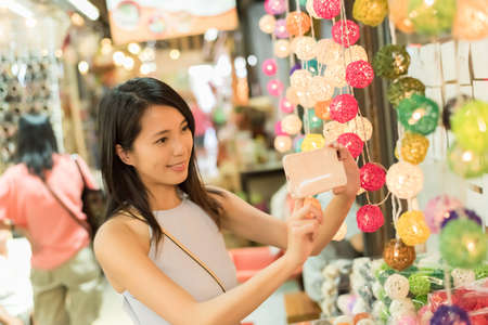 thailand culture: asian young woman traveling and shopping at Chatuchak weekend market, Bangkok, Thailand