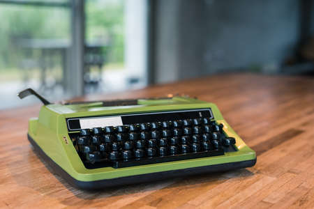 vintage typewriter in green color on the desk