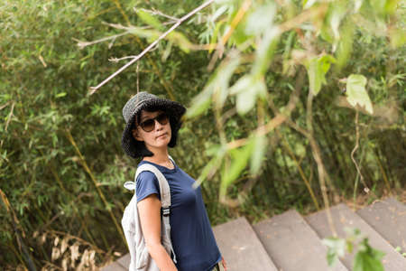 portrait of Asian woman hiking with backpack at outdoor