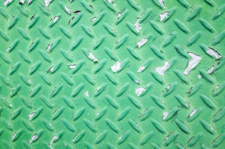 background of metal diamond plate in green color Imagens