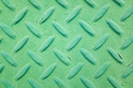 background of metal diamond plate in green color Stock Photo