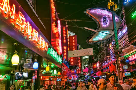 Bangkok, Thailand - Feb 16, 2017: crowded street Soi Cowboy at night, a famous red-light area, one of centers of prostitution and sex tourism in Bangkok city. Editorial