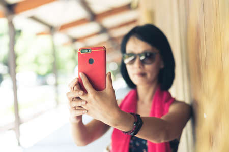 woman take a selfie at the corridor at the station