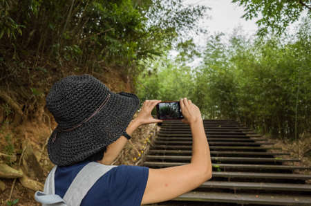 woman take a picture when hiking at outdoor
