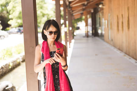 woman using cellphone at the corridor at the station