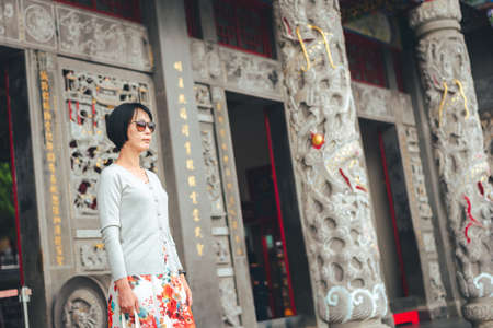 portrait of Asian woman stand in the Wenwu temple at Sun Moon Lake, Taiwan
