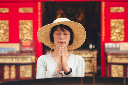 traveling woman burn incense and pray in Wenwu temple, Taiwan 스톡 콘텐츠