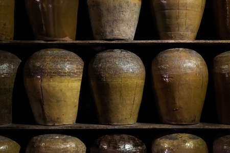 rows of fermented alcoholic beverage in the old pottery at Puli Brewery, Nantou, Taiwan 스톡 콘텐츠