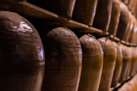rows of fermented alcoholic beverage in the old pottery at Puli Brewery, Nantou, Taiwan Reklamní fotografie