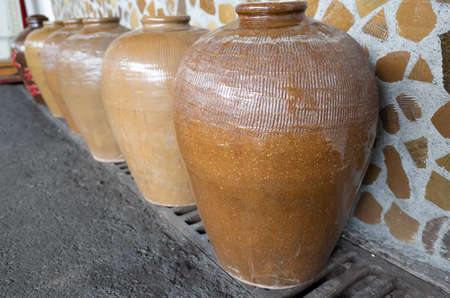 rows of fermented alcoholic beverage in the old pottery at Puli Brewery, Nantou, Taiwan Banco de Imagens