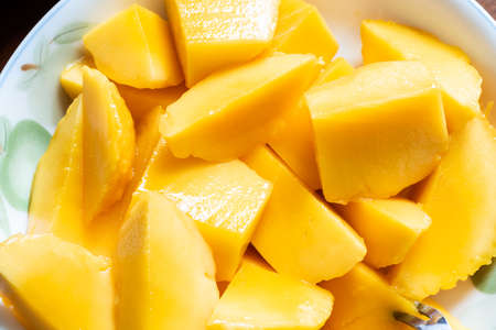 pieces of yellow mango on a dish