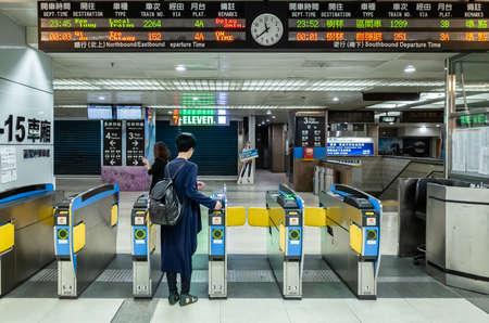 Taipei, Taiwan - May 10th, 2019:passenger walk through the gate at train station, Taipei, Taiwan, Asia