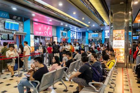 Taipei, Taiwan - Jun 6th, 2019: people with Taipei long distance bus station building at Taipei, Taiwan