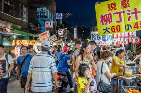 Taipei, Taiwan - Jun 8th, 2019: people walk and shop in a night marketplace at Taipei, Taiwan, Asia