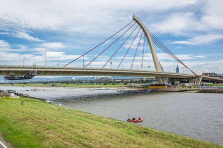 Taipei, Taiwan - Jun 9th, 2019: cityscape with bridge with river under sky at Taipei, Taiwan, Asia