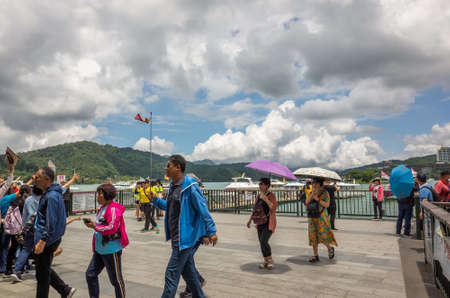 Nantou, Taiwan - May 30th, 2019: tourists and boats at Xuanguang temple pier in Sun Moon Lake, Nantou, Taiwan