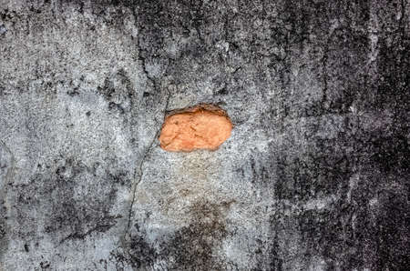 grunge gray wall background with crack and bricks