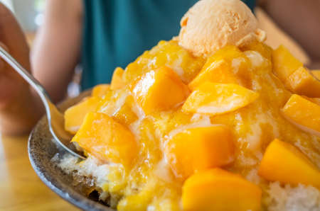 eating mango shaved ice with colorful dessert, famous Taiwanese snacks at Taiwan Stock Photo