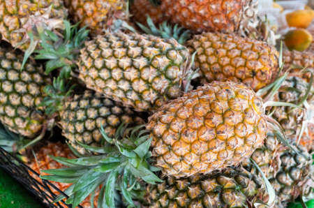 group of pineapple fruit at traditional marketplace in Taiwan