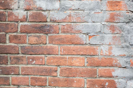 background of red bricks wall with gray cement