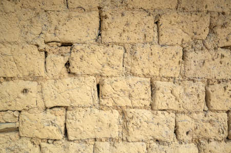 old yellow mud brick wall background with good texture