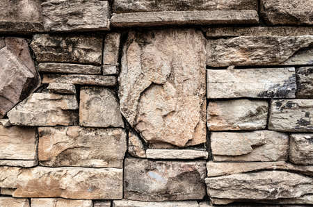stone stacked wall in brown aged color background