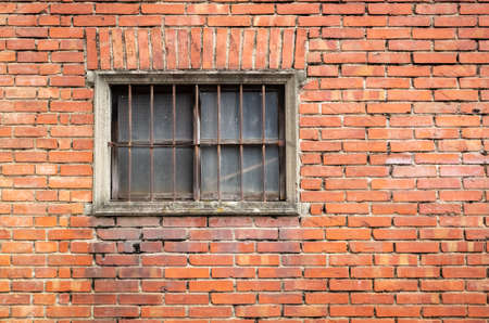 old window on red brick wall Banco de Imagens