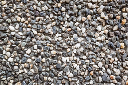 small rock or stones on cement wall