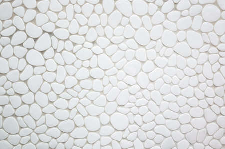 wall of oval and round stone on white background