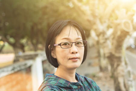 portrait of Asian mature woman at the street